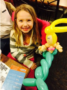 A denver girl with a balloon animal mermaid from smiles the clown