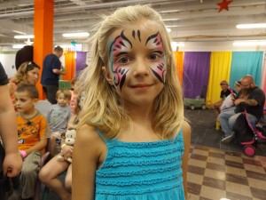 A young lady with butterfly face painting in denver