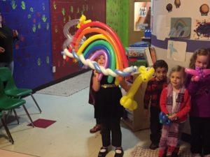 balloon twisting rainbow birthday party