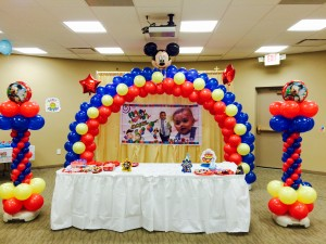 A red and blue mickey mouse arch with matching columns