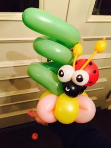 A Balloon twisting ladybug on a flower