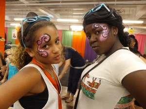 Two teenage girls with swirly face paint
