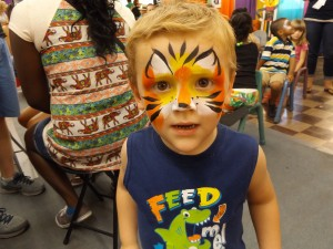 A cute little boy painted like a tiger