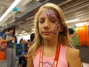 pink, white, and black swirly face painting design