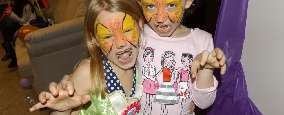 face painting for kids: in this case they are two leopards
