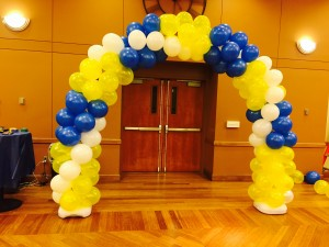 A simple white blue and gold balloon arch