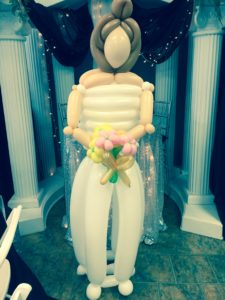 A six-foot tall bride made of twisted balloons