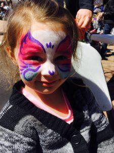 A little girl with kitten face paint