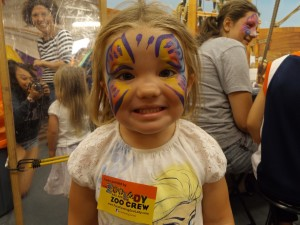 A small girl painted as a butterfly