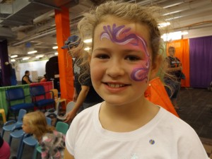 Pink and purple swirly face paint
