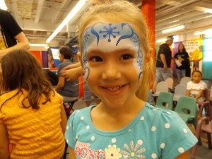 Blue and white face paint with snowflakes and princess designs