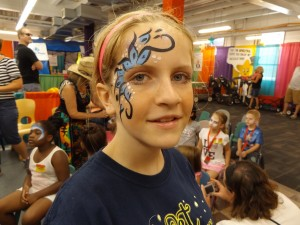 Black, white, and blue flowers on a denver face painting