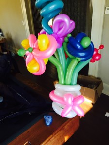a balloon flower bouquet made by a balloon twister