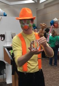 Denver Clown smiles the clown doing an illusion