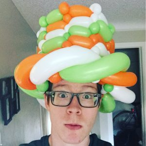 the best denver entertainer in a balloon twisted hat